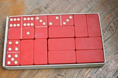 This is a box of red vintage dominos. The dominos are in very good condition but the box is not. They are colorful and not faded. there are 28 Dinner Party Games, Colorful, Box, Vintage, Etsy, Snare Drum, Vintage Comics