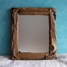 This rectangle mirror has a wrap around style of construction, with driftwood on the face of the frame, as well as the inside and outside edges. Description from etsy.com. I searched for this on bing.com/images