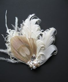 Wedding bridal hair feather fascinator peacock accessory Beige nude cream ivory Vintage inspired rhinestone with tulle head piece pearl. $38.00, via Etsy.