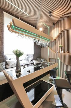 Sci-Fi Kitchen in Moscow Exhibiting a Striking Choice of Colors and Materials