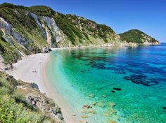 Spiaggia di Sansone, Tuscany: Located on Isola d'Elba (Elba island), just a short ferry ride from the region's rolling hills and vineyards, this beach is peppered with smooth white pebbles. Vacation Destinations, Dream Vacations, Vacation Spots, Italy Vacation, Italy Trip, Most Beautiful Beaches, Beautiful Places, Amazing Places, The Places Youll Go