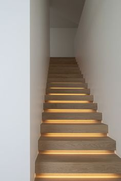 Wood staircase with lighting that creates a soft glow