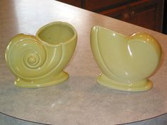 pair Trenton Pottery TAC nautilus Shell yellow chartreuse Vase planter vases by Junctique on Etsy https://www.etsy.com/listing/124612994/pair-trenton-pottery-tac-nautilus-shell
