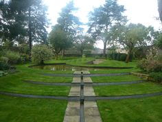Formal water garden, inspired by the houses historic link to Studley Royal and Fountains Abbey water gardens.