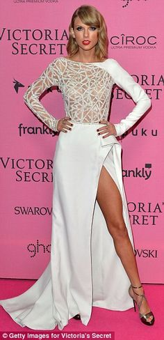 Taylor also showed off her bronzed limbs in a semi see-through sparkling white gown