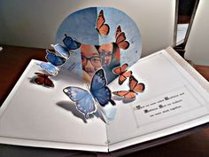 Butterflies surround Pop-Up photo.