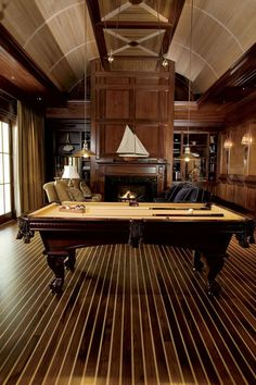 A real man's parlor!  The ceiling and floor of the room mimic a ship.