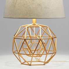 Featuring a smaller gold globe that appears to float inside its larger twin, our exclusive desk lamp is a remarkable sculpture. Charles Eames, Gold Globe, Gold Everything, Bedroom Lamps, Bedroom Decor, Lamp Sets, Art Deco Design, Home Lighting, Cut Glass