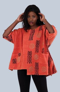 Heavy Cloth Tribal Dashiki Shirt - Stylish and comfortable this Heavy Cloth Tribal Dashiki is a versatile piece for any wardrobe. The loose and flowing dashiki has an authentic African pattern printed on it and uneven hemline. Available in white, black and brown.  Traditional African tribal style shirt with bold African patterns.  Celebrate your love of African culture and fashion with this beautiful African shirt.  #africa #african #shirt #fashion #style #stylish #womensstyle #pattern