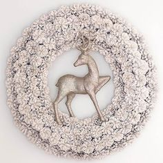 Adorn your plain pinecone wreath with eye-popping metallic spray and a stately reindeer. To make the snowy stunner, spray-paint the pinecone wreath with a few coats of ivory spray. Once dry, hot-glue the reindeer to the center of the wreath. Look for materials at your local crafts store.