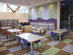 This children area's TMC furniture perfectly integrates the shapes and colors of the patterned floor and walls. Don't worry about struggling to find library furniture that complements a unique space like this. TMC offers 40 standard wood finishes, so you are bound to find furniture to match any space. (Even in purple and orange!)