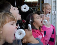Happy Donut Day! Tie powdered donuts on a string in your garage or front porch or clothes lines for a fun game. If you can't find powdered donuts, or just want to have way more fun, add extra powdered sugar to the donuts before you hang them. Oh and you can't use your hands to eat them!