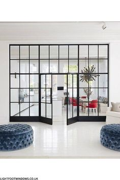 We love the look of this black framed glass wall for potential third bedroom/home office/anywhere it make sense!