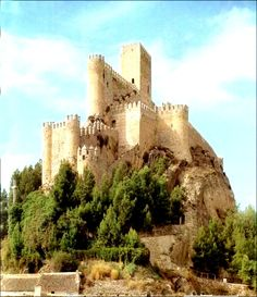 """CASTLES OF SPAIN - Castle of Almansa, Albacete. One of the most beautiful castle in Spain, is perched on a steep rocky place that raises its spectacular silhouette on the plain. We are facing a border fortress between the kingdoms of Castile and Aragon and the Muslim kingdom of Murcia. The castle it belonged to the kingdom of Murcia, and was not until the reign of Ferdinand III of Castile, """"the Saint"""", when the kingdom of Murcia surrendered (1244) to Prince Alfonso,( Alfonso X """"the Wise"""")."""