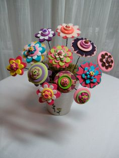 button flowers using plastic buttons and felt petals. you can do it yourself .will be very whimsical bouquet.