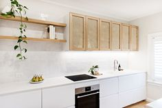 Interior designer Tim Connah and his partner Grae cleverly transformed their one-bedroom Manly apartment into a cool coastal abode. Kitchen Interior, New Kitchen, Kitchen Decor, Kitchen Cupboards, House And Home Magazine, Rattan, Home Kitchens, Sweet Home, House Design