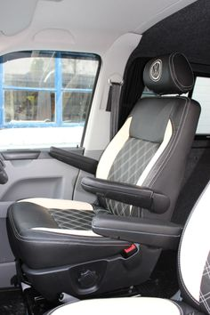 We have just fitted these gorgeous VW T5 Captain's chairs re-upholstered in Black And Cream Leather with Bentley Stitching and matching Cream VW embroidery. These are the seats that we plasti-dipped from light grey to black to match the van interior.