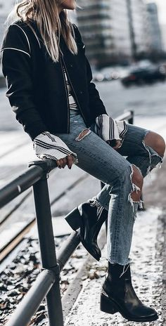 street style outfit: jacket rips