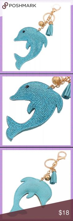 "HPTurq. Blue Crystal Dolphin Key Chain/Fob RE-STOCKEDGorgeous Turquoise Blue Crystal Dolphin Key Chain/Fob with leather tassel and decorative gold ball. Felt backing, so if you hang it from your bag it won't cause any damage. The crystals sparkle so bright in the light. Approx. 7"" Long, hang it from your purse, use for your keys, hang from rear-view mirror, etc. so many possibilities! SOLD A LOT OF THESE WITH RAVE REVIEWS! Boutique Accessories Key & Card Holders"