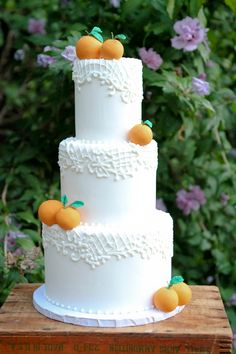 3 Tiered piped lace and handmade sugar orange Wedding Cake by Vanilla Bake Shop