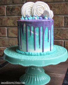 purple and teal drip cake finished brick background