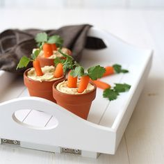 Hummus and carrots are always a great go-to snack, but prepare them together as an Easter-themed treat and it's a game changer. You'll need baby carrots, fresh cilantro or parsley, and terra-cotta pots filled with your favorite flavor of hummus. Easter Snacks, Easter Candy, Easter Brunch, Easter Treats, Sunday Brunch, Easter Recipes, Holiday Recipes, Easter Food, Junk Food
