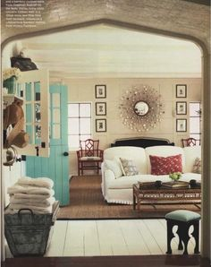 repining for you hollie,  a turquoise dutch door reminded me of you.  Neutral room w/ small pops of color.
