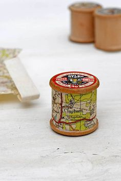 Have you noticed that most old road maps are printed in festive colours. That is the roads are often printed in red and rural areas in green all on a white back… Christmas Ornaments To Make, Christmas Colors, Simple Christmas, Christmas Crafts, Christmas Decorations, Holiday Decorating, Displaying Kids Artwork, Map Crafts, Berry Baskets