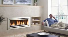 """Love the """"landscape"""" fireplace with cobalt blue stones. Regency Fireplace Products"""