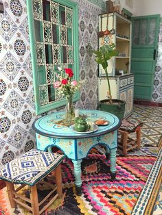Beautiful boho setting at Riad Be Marrakech :: interesting colorway: neutral patterned wall tiles, single color accent, and bright patterened floor. Moroccan Table, Moroccan Furniture, Moroccan Interiors, Moroccan Decor, Bohemian Interior, Bohemian Decor, Patterned Wall Tiles, Cheap Modular Homes, Global Decor