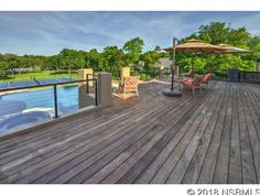 Two-story mansion on the river with outdoor wood deck overlooking swimming pool and tennis court! Pine Bluff, Ormond Beach, Types Of Houses, Future House, Swimming Pools, Home And Family, Deck, Backyard, Mansions