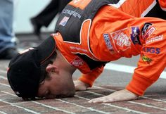 ** FILE ** Tony Stewart kisses the yard of bricks on the start/finish line after winning the Allstate 400 at the Brickyard at the Indianapolis Motor Speedway, in this Aug. 7, 2005,  in Indianapolis.  (AP Photo/Tom Strattman) Photo: TOM STRATTMAN / AP
