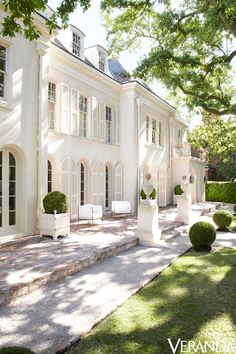 With a mix of the refined, the rustic, and many shades of white, a Houston house gets an update. Interior design by Pamela Pierce.   - Veranda.com
