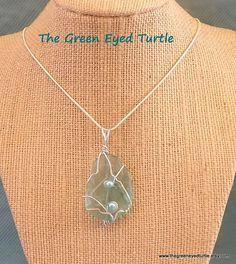 Hey, I found this really awesome Etsy listing at https://www.etsy.com/listing/245592163/wire-wrapped-teal-sea-glass-necklace-on