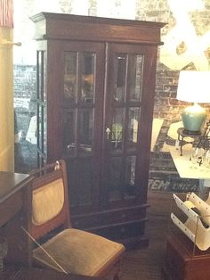 Tall, dark and handsome... This curio cabinet features beveled glass panes and extra storage space below. Message for pricing and info.
