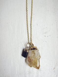 Black Tourmaline, Citrine. The tourmaline would absorb all the negative energy as the citrine naturally cleanse the tourmaline of all negative energy, transforming it out back into the flow as positive vibes.
