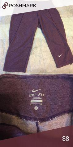 Super comfy Nike workout Capris GUC.  Purple Nike dri-fit workout capris! Has rouged sides. Nike Pants Capris