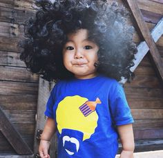 "Happy Thursday everyone! Absolutely love this funky snap of petit Tobias in our #MÔMES ""Afi"" tee  So hillarious @aliciaadnan  Browse our designs at www.momes-store.com ❤️ #afro#retro#handcrafted#organiccotton#afi#toocuteforschool"