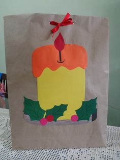 Embrulho de natal.Utilizando papel craft. Motivo: Vela