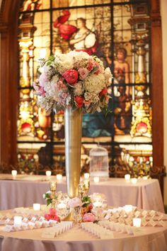 Escort Card Table with Large Gold Trumpet Vase with large, lush, white blush floral.  Germania Place Wedding. Kenny Kim Photography. Sweetchic Events. Vale of Enna.