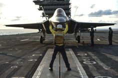 ATLANTIC OCEAN (Aug. 18, 2016) Aviation Boatswain's Mate (Handling) 3rd Class Juan Cumpston directs an F-35C Lightning II carrier variant, assigned to the Salty Dogs of Air Test and Evaluation Squadron (VX) 23, to the catapult on the flight deck of the aircraft carrier USS George Washington (CVN 73). VX-23 is conducting its third and final developmental test (DT-III) phase aboard George Washington in the Atlantic Ocean. The F-35C is expected to be Fleet operational in 2018. (U.S. Navy photo…