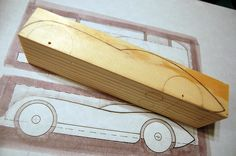 2009 Pinewood Derby Car #1 (Step 2, tracing the sketch on the pine block) by cdubya1971, via Flickr