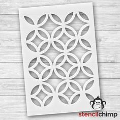 Add some sass to your living space with this geometric stencil pattern. Use it to add pizzazz to a table, or go big with an accent wall, the options are endless (no pun intended). This design is very versatile- use bright primary colors for a kids space, apply muted tones for a softer feel or create a subtle effect by using gloss to your flat paint. * Stencil Sizing *  The Mylar sheet is 12 x 17.5  The actual stencil size is 10.43 x 14.86 The inside circle measures 4 x 4 * Stencil Content…
