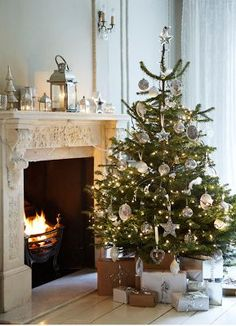 I like the simplicity of this swwet treee but please-  it is way too close to the fire.   #christmas #christmastree