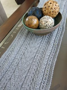 Free Knitting Pattern: Lace & Cables Table Runner. It would make a nice wrap or, widened, afghan.