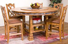 This beautiful Rustic Oak Dining Table features leg extensions that allow you to have both a regular dining table, or, with the included leg extensions in, a bistro height table whenever you desire. The center of the dining table also incorporates a large, slate inlaid lazy susan; perfect for easily passing food around the table to other family members. The slate inlays are also painstakingly detailed around the entire edge of the round table, for a wonderful color complement to the oak…