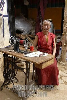 photos of old buddhist monks   Stock Photography image of Buddhist monk working with an old Singer ...