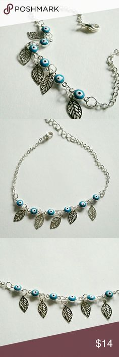 "Evil eye leaf bracelet Dainty silver-toned chain bracelet with delicate leaf and light blue evil eye charms. Super cute   7.5"" long, with 1.75"" extension Wild Rose Boutique Jewelry Bracelets"