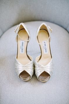 Sarah walked down the aisle wearing shimmering, metallic peep-toe heels by Jimmy Choo. #heels #JimmyChoo Photography: James Christianson