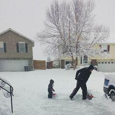 Ryan and Roman shoveling snow Christmas Eve day. by charlong